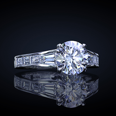 Custom made solitaire featuring a round diamond with channel set custom cut baguettes by Leon Mege.