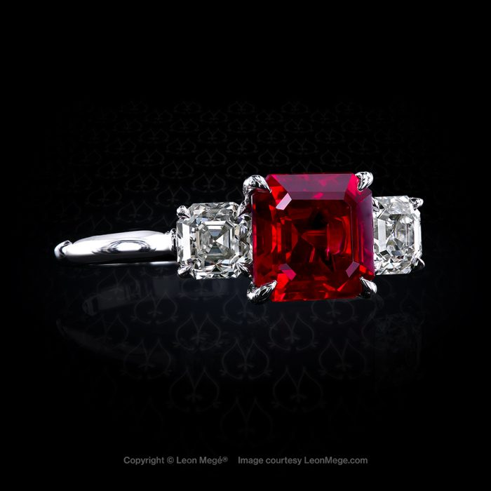Classic three-stone ring featuring 2.06 carat asscher ruby by Leon Mege