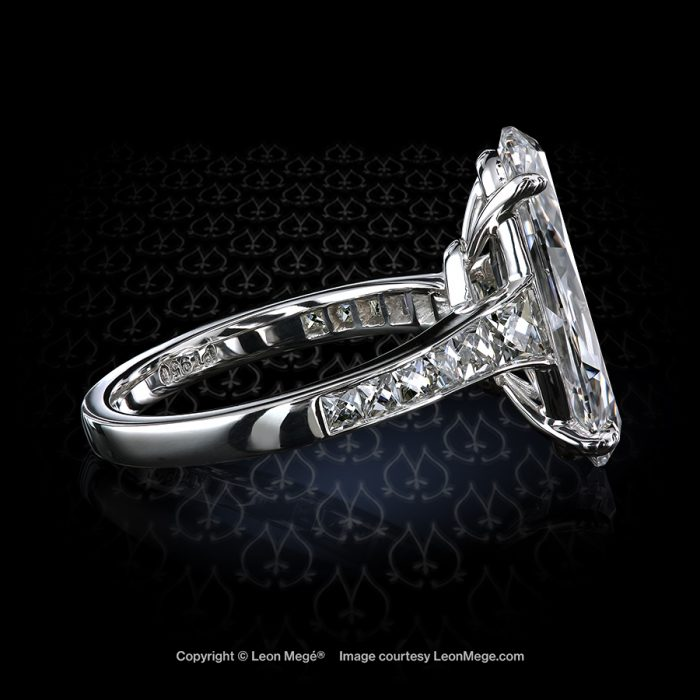 Custom made ring with 5.04 carat D/VS1 oval - moval diamond and layout of French cut diamonds by Leon Mege.