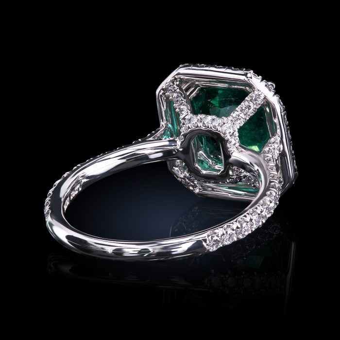 Leon Mege double halo ring with natural Colombian emerald and micro pave diamonds.
