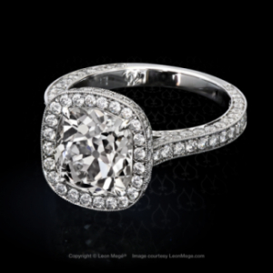 Heidy halo ring featuring a True Antique cushion diamond by Leon Mege.