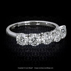 five-stone platinum band with round diamonds by Leon Mege
