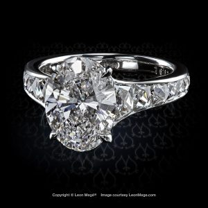 Mon Cheri diamond ring with oval diamond and French cut diamond by Leon Mege